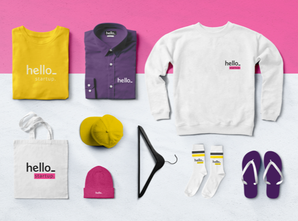 A selection of branded clothing on a pink and white background.